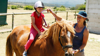 This image has an empty alt attribute; its file name is HORSE-RIDING_350-197.jpg